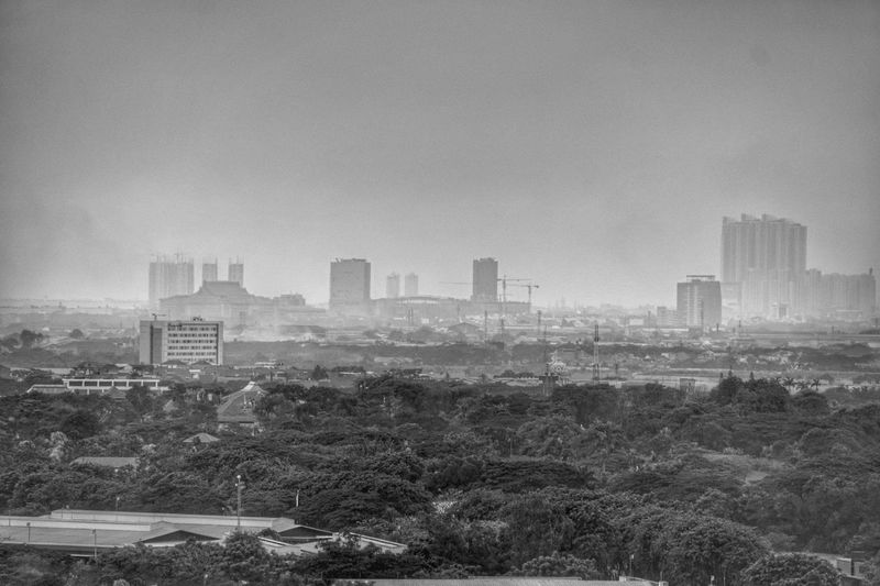 pollution Polution City Cityscape Urban Skyline Skyscraper Modern Downtown District Fog High Angle View Sky Architecture Film Noir Style Smog Air Pollution A New Beginning EyeEmNewHere
