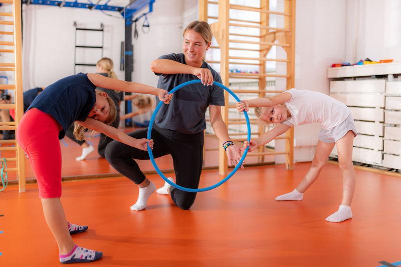 Hula hoop ring torsion exercise for children