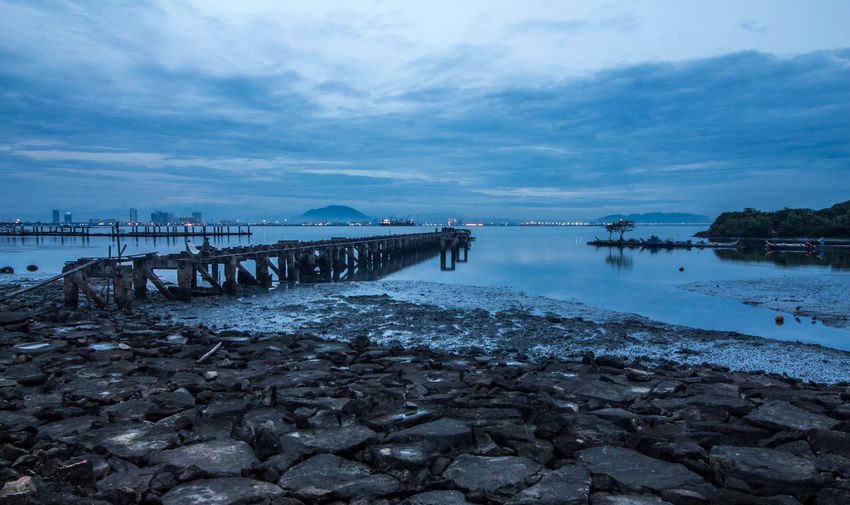 Blue Hours at Karpal Singh Drive, Penang, Malaysia. Architecture Beach Beauty In Nature Built Structure Cloud - Sky Day Groyne Harbor Horizon Over Water Idyllic Jetty Nature No People Outdoors Pier Rock - Object Scenics Sea Sky Tranquil Scene Tranquility Water