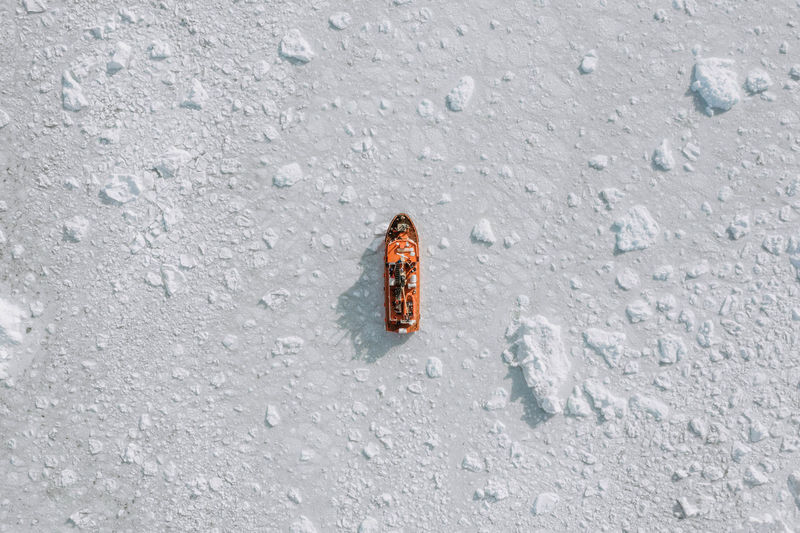 High angle view of woman walking on snow