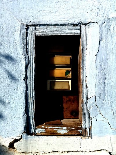 Low angle view of window on old building