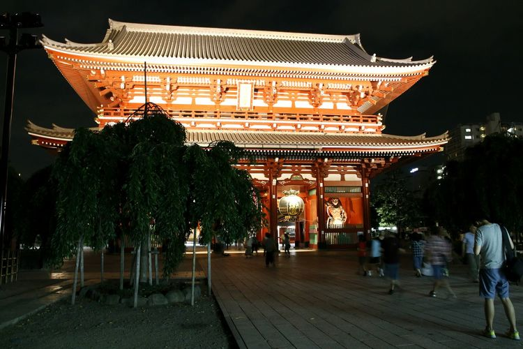 Illuminated temple against sky at night