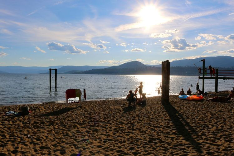 Adult Beach Beauty In Nature Cloud - Sky Day Gyro Beach Horizon Over Water Kelowna,BC Nature Outdoors People Real People Sand Scenics Sea Sky Sunlight Sunset Water