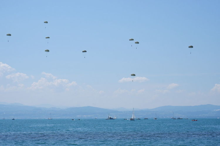 Bodensee Paratroopers Paratrooper Parachute Flying Sea Water Mid-air Sky Ship Yachting Regatta Boat Deck Sailor Helm Yacht The Photojournalist - 2018 EyeEm Awards