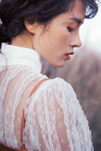 Side view of young woman with eyes closed