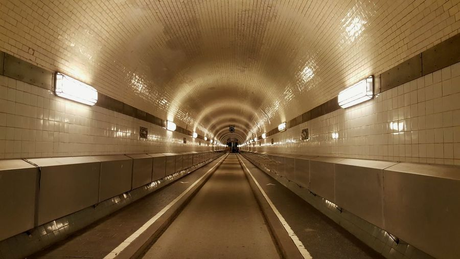 Alter Elbtunnel Elbtunnel Hamburg Germany Travel Destinations Travel Traveling Tunnel View Bw Sepia Lonely Loneliness Hamburgmeineperle Citytrip Städtereise View No People Illuminated Indoors  Tunnel Architecture The Way Forward Travel Built Structure Tile Travel Destinations
