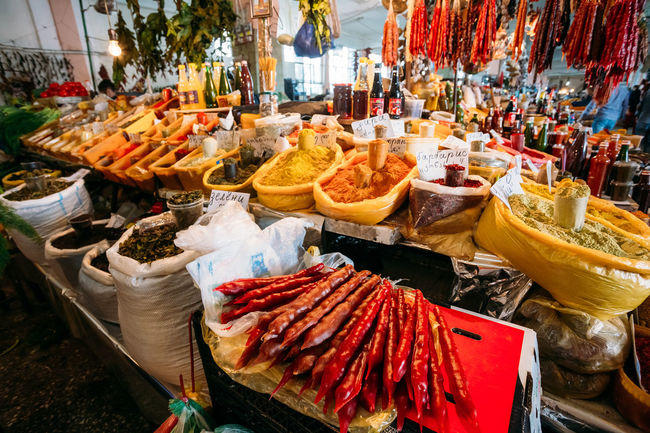 Batumi, Georgia. Heap Of Churchkhela, Traditional Georgian Candle Shaped Candy Lying On Sale At The Abundant Counter Of Fragrant Spices And Herbs At The Covered Market, Bazar. Batumi Bazaar Candle Georgia Herbs Lying Market Sale Adjara Candy Churchkhela Close-up Covered Food Food And Drink Food Stories Fragrant Healthy Eating Heap Retail  Shapped Spices Tourism Traditional