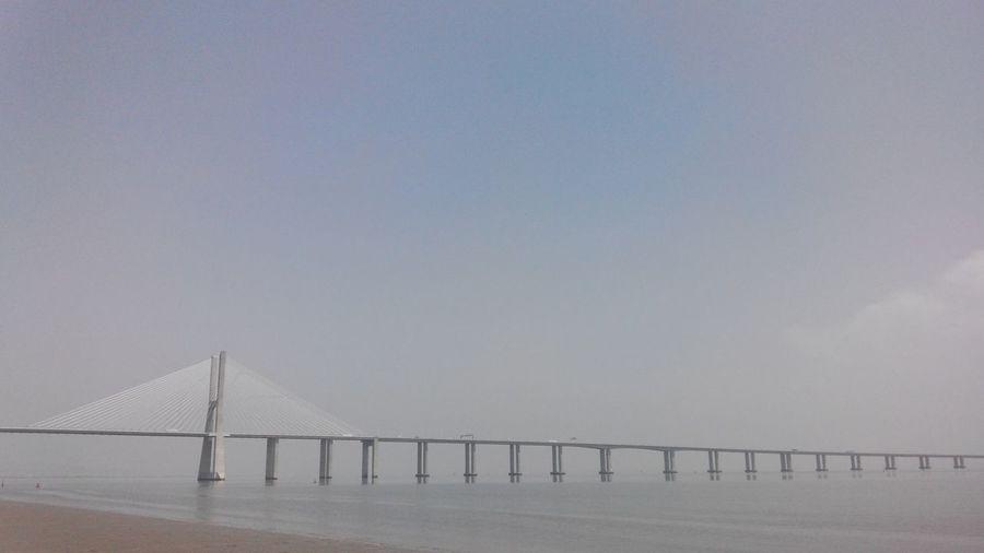 Vasco Da Gama Bridge Over Tagus River Against Sky