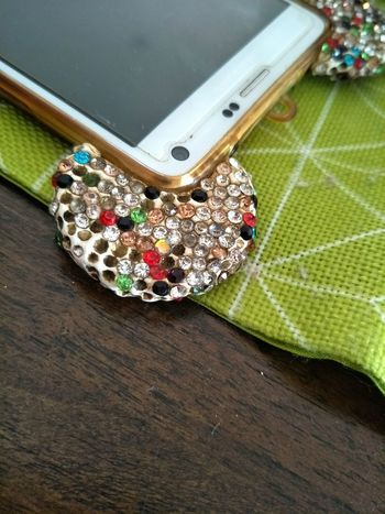 Smart phone casing with colored crystals Meru Smart Phone Crystal Colored Table Cloth Green Cloth Wood Table Wood Heart Shape High Angle View No People Indoors  Close-up Day Christmas Decoration