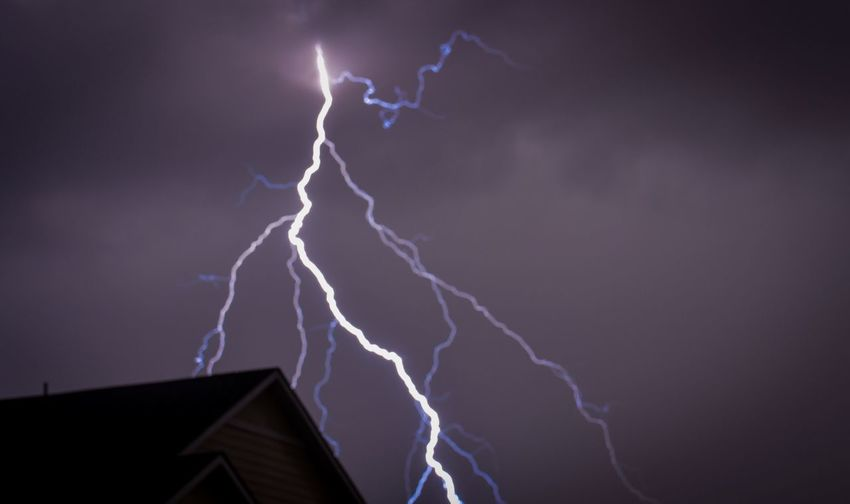 Architecture Building Exterior Thunderstorm Built Structure Power In Nature Low Angle View Lightning Danger Storm House Sky Environment Dramatic Sky High Section Night Storm Cloud Illuminated Roof Cloud - Sky Outdoors