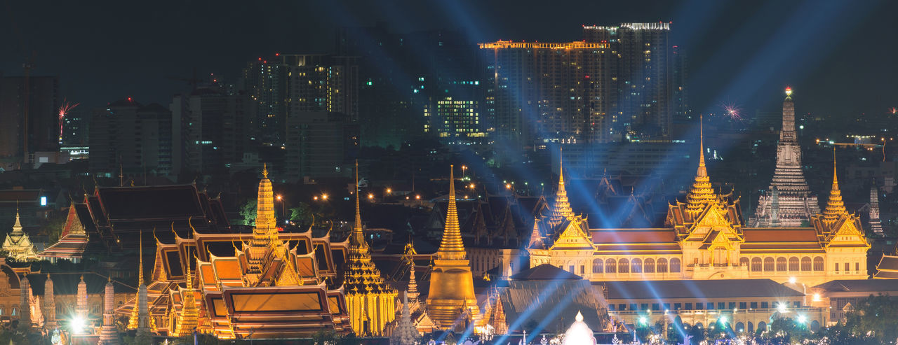 The Emerald Buddha at Sunset, Bangkok, Thailand Emerald Buddha Temple Grand Palace Bangkok Thailand Architecture Building Exterior Built Structure City Cityscape Illuminated Night No People Outdoors Sky Skyscraper Sunset