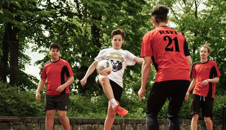 Soccer Soccer Ball Sport Soccer Uniform Group Of People Soccer Player Tree Sports Uniform Soccer Field Outdoors Sports Team Day Togetherness Playing Competition Sports Clothing Ball Red Friendship People