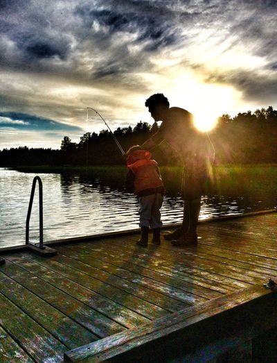 Summertime Fishing Father & Son Sunset Lifejacket Pier Fishing July 2016 Vacay2016 Enjoying Life Son Husband Blidö Friends For Life  Archipelago Island Life Greatful  People Together Nature Sky And Clouds Dramatic Sky Sunlight Still Water