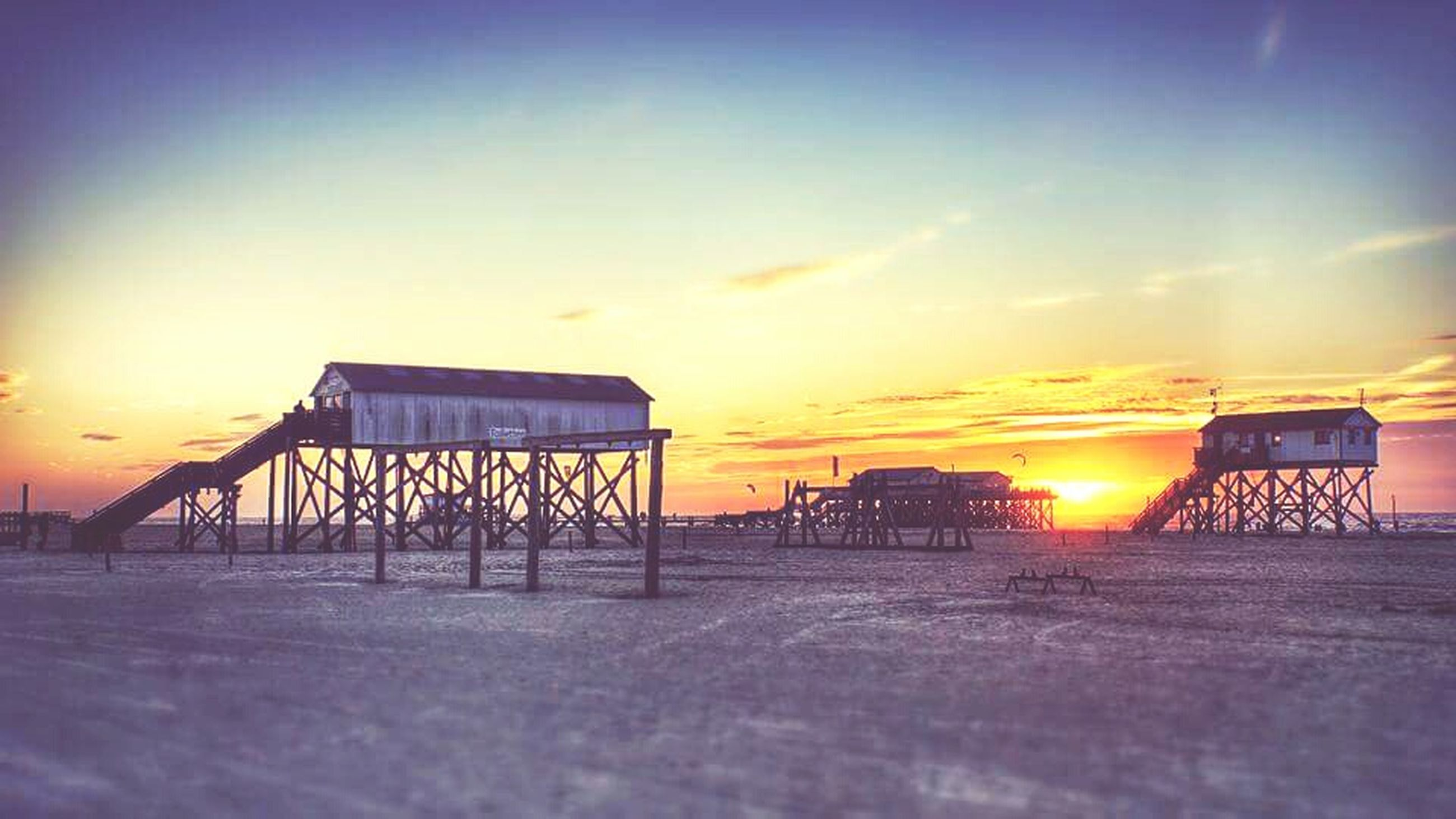 sunset, surface level, built structure, tranquil scene, architecture, tranquility, sky, outdoors, scenics, cloud, sun, agriculture, farm, beauty in nature, blue, nature, harvesting