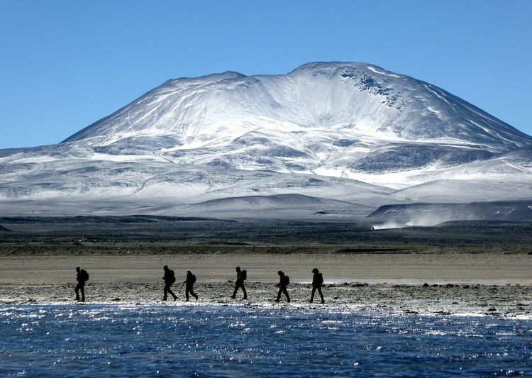 Tourists Passing Through Snow Covered Mountain