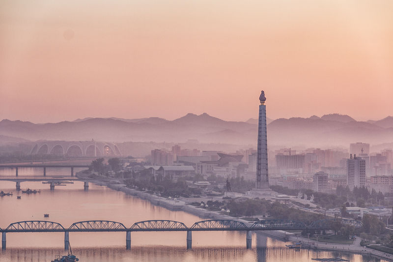 Architecture Bridge Bridge - Man Made Structure Building Exterior Built Structure City Cityscape Connection Fog Juche Tower Mountain Nature No People Office Building Exterior Outdoors Pyongyang River Sky Skyscraper Sunset Taedong-gang Transportation Travel Travel Destinations Water