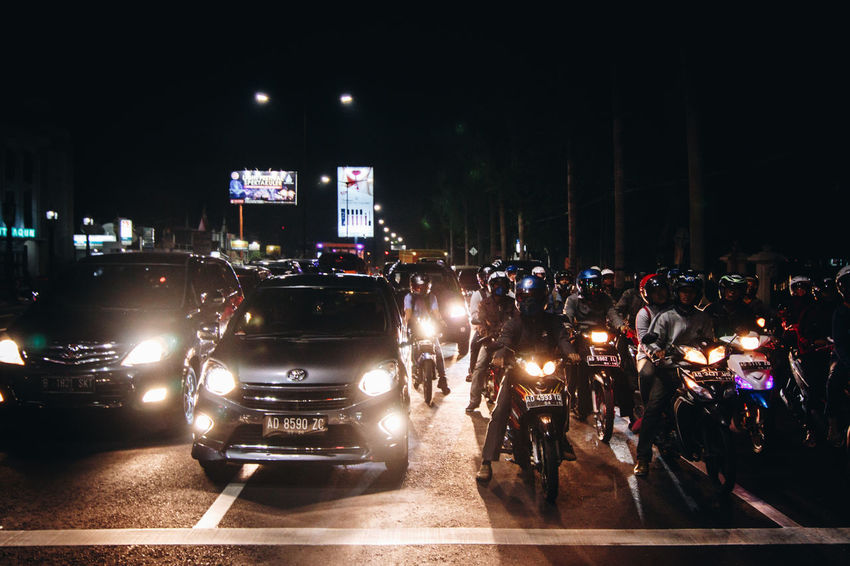 Architecture City Crowd Illuminated Land Vehicle Large Group Of People Men Mode Of Transport Motorcycle Night Nightlife Outdoors People Real People Road Transportation