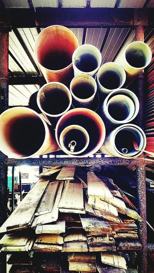 Check This Out Round pipe and . at an open warehouse. Colorful Portrait Geomatric Shapes
