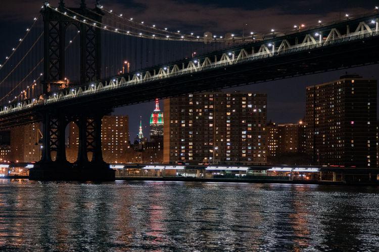 Illuminated Brooklyn Bridge Over River