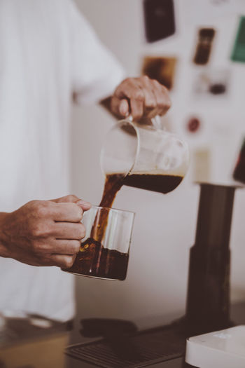 Bar Barista Beverage Black Brew Brown Cafe Coffee Drink Fresh Glass Hand Hot Lifestyle Man Plastic Pour Practise Prepare Press Professional Relax Selective Focus Serve Water White Work