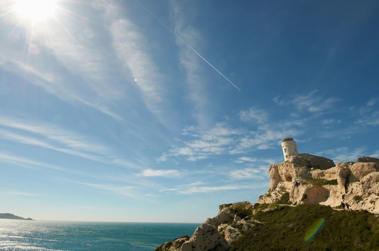 Chateau D'if Sky Beauty In Nature Cloud - Sky Sea Water Tranquility Sunlight Tranquil Scene Horizon Rock Rock Formation Marseille Mittelmeer Mediterranean  Low Angle View Horizon Over Water Lens Flare Nature