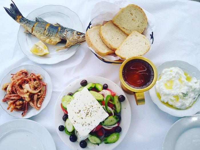 Mediterranean lunch Seabass Grilled Seabass Calamari Feta Salad Greek Food Albania Visit Albania Himare Himare Albania Mediterranean Lunch Summer Lunch  Lunchtime Fish Lunch EyeEm Selects Plate Directly Above High Angle View Food And Drink Sweet Food Food Styling