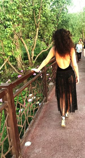Rear View Real People Plant Leisure Activity Lifestyles Full Length One Person Tree Women Casual Clothing Day Nature Child Growth Adult Childhood Standing Walking Girls Outdoors