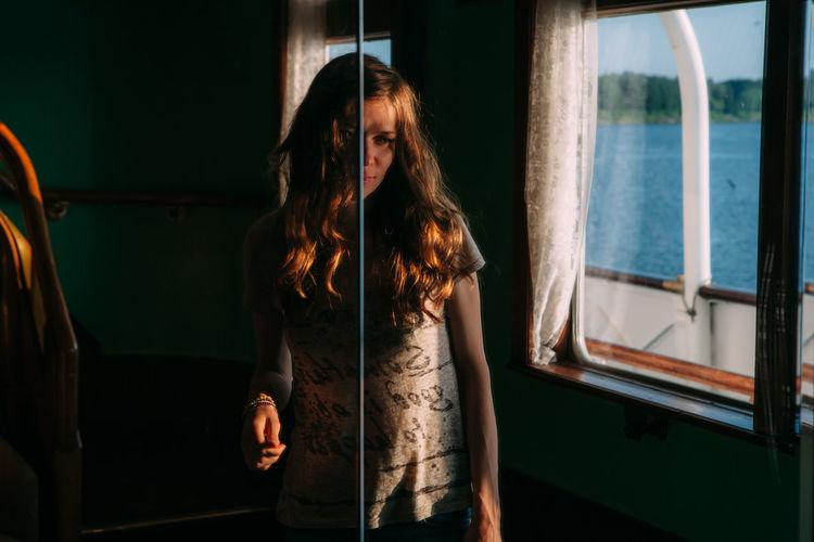 Woman Standing In Ferry By Window