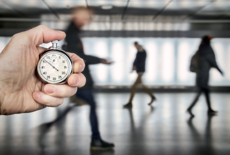 people rushing to work Blurred Motion Hand Human Hand Holding Human Body Part Focus On Foreground Indoors  Time Clock People Architecture Real People Men Adult Women Day Body Part Occupation Stopwatch Hurry Rush Hour Stress Motion Blur