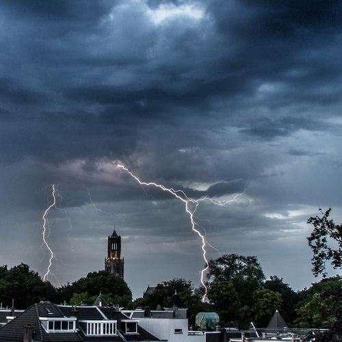 Lightning crashes from major Thunderstorm and forming a nice arc around the Domkerk in Utrecht , Netherlands