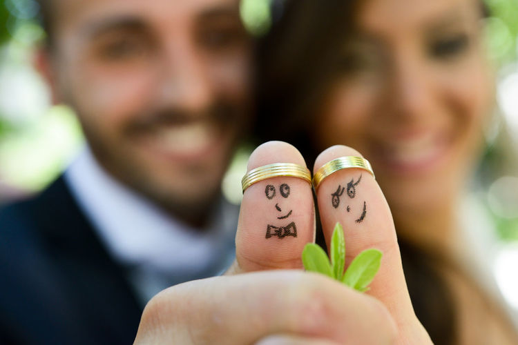 Anthropomorphic Faces Drawn On Thumbs With Rings Of Wedding Couple