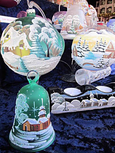 Several painted Christmas decorations, bells, candle holder and baubles, on display at a Christmas market Baubles Bell Candle Holder Celebration Christmas Bell Christmas Market Christmas Time Holiday Market Montreux Ornament Winter Christmas Baubles Christmas Candle Holder Christmas Elements Christmas Present Closeup Decorations Glass Painted Christmas Decorations