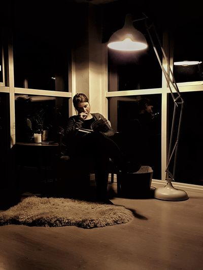 One Person People Sitting Indoors  Portrait Reading A Book Sitting In A Chair Low Light HUAWEI Photo Award: After Dark