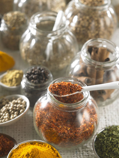 Close-up of various spices on burlap