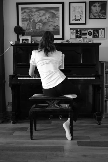 Aurelia at Piano Black & White Piano Moments Relaxing Blackandwhite Photography Full Length House Indoors  Leisure Activity Music Musical Instrument One Person Pianist Piano Real People Rear View Sitting Study Time Unusual Perspective Women Inner Power