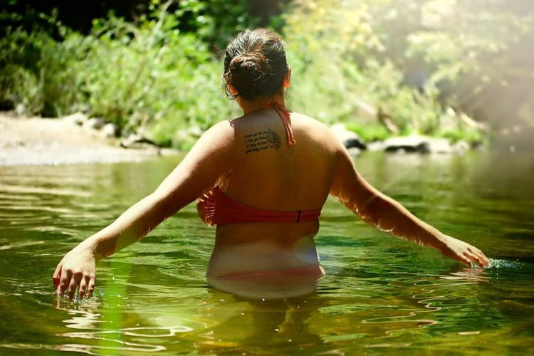 Rear View Of Woman In Water