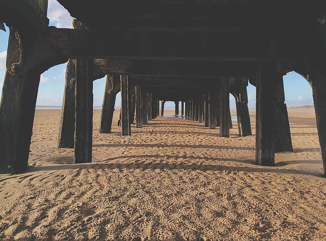 beach, sand, sea, underneath, architecture, pier, built structure, architectural column, day, sunlight, the way forward, below, horizon over water, no people, indoors, nature