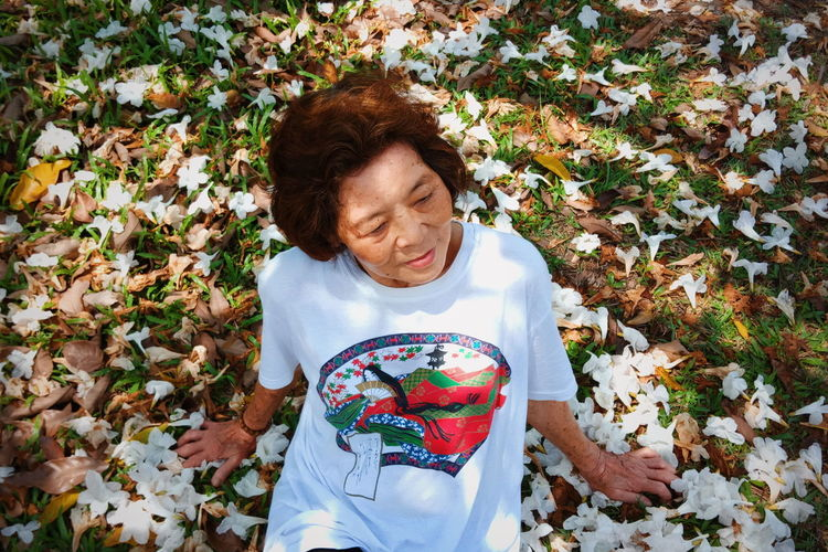 High angle view of woman with autumn leaves