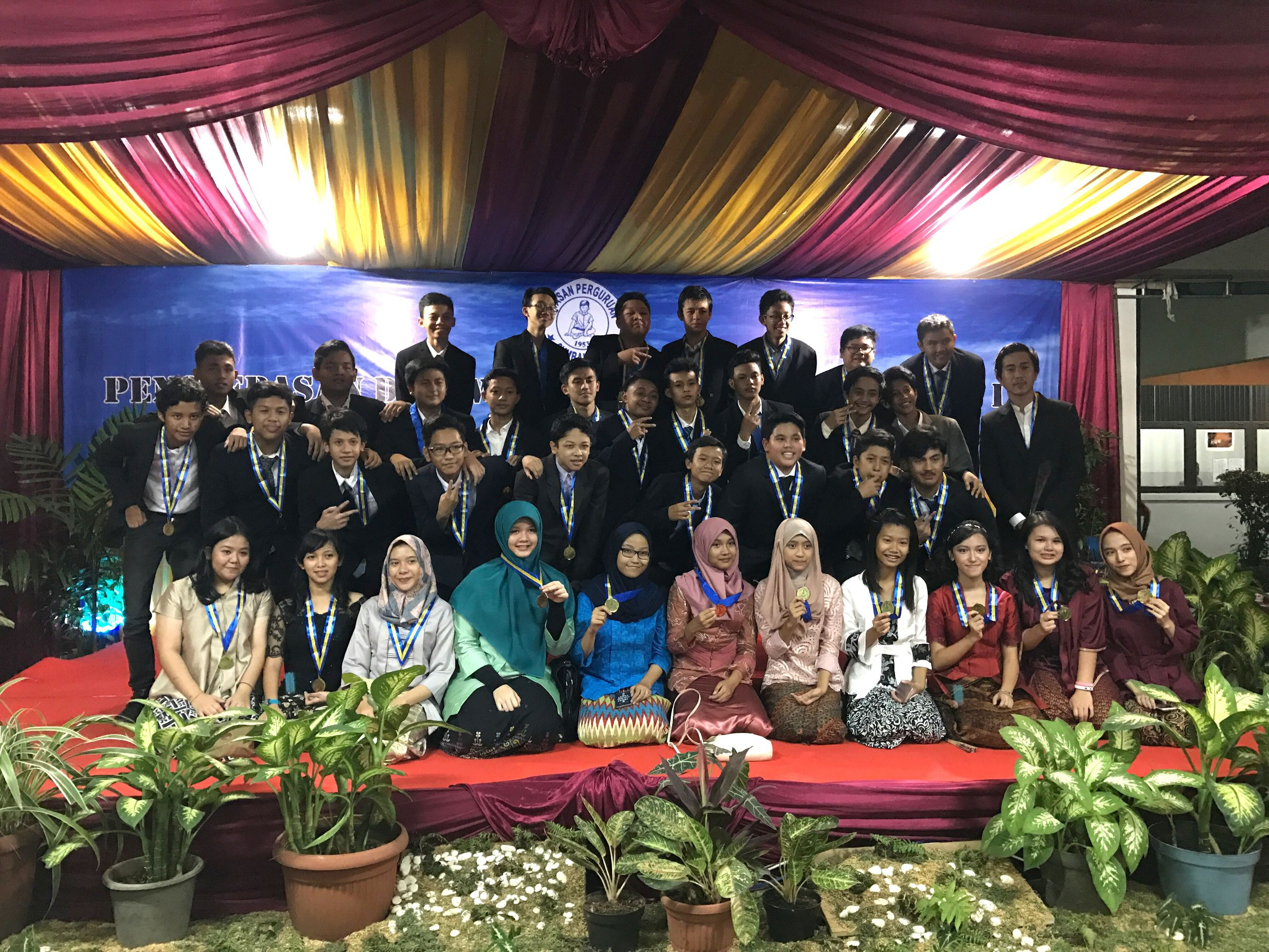 large group of people, indoors, real people, illuminated, leisure activity, men, curtain, sitting, enjoyment, lifestyles, crowd, standing, audience, arts culture and entertainment, women, young adult, day, people