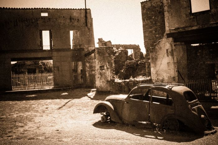 Never Forget !! Horror Oradour Sur Glane WWII War Memorial Abandoned Black And White Blackandwhite Bnw_echoes_of_the_past Bnw_friday_eyeemchallenge Building Exterior Built Structure Car Damaged Motor Vehicle Never Forget No People Outdoors People Remember Sepia Souvenir