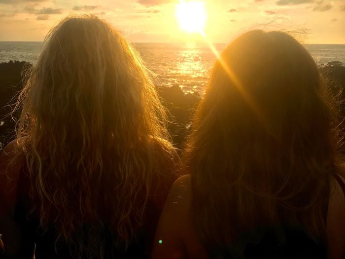 Together Rear View Sunlight Real People Water Sunset Long Hair Beach Friendship Sea Togetherness Women Two People Horizon Over Water Beauty In Nature Leisure Activity Outdoors Nature Day Close-up