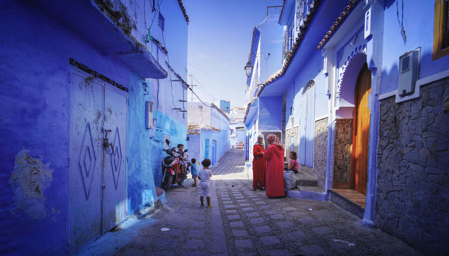 """""""The Blue City"""" - A day in the life in Chefchaouen Chefchaouen Chefchaouen Medina Chefchaouen Blue City Morocco Travel Destinations Travel Travel Photography Digital Nomad Tourism Tourist Attraction  Tourist Destination EyeEmNewHere EyeEm Best Shots Architecture Building Exterior Built Structure Real People Building Women Group Of People City Men People Street Lifestyles Full Length Adult Direction Footpath The Way Forward Walking Child Outdoors Alley"""