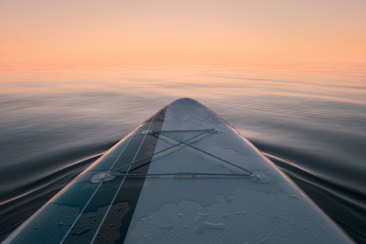 Paddleboard at sea. view from the board. sunset time.
