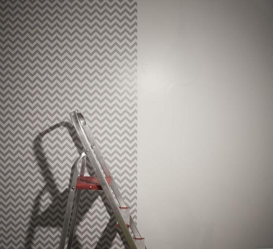 Metal step ladder by wall