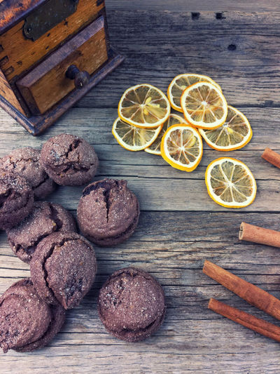 Cookies Brown Cinnamon Citrus Fruit Cross Section Day Decoration Food Freshness Fruit Indoors  Lemon No People SLICE Sweets Table Vintage Wood - Material