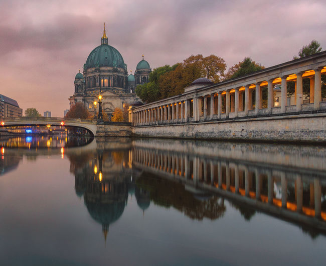 Berlin cathedral against cloudy sky during sunset