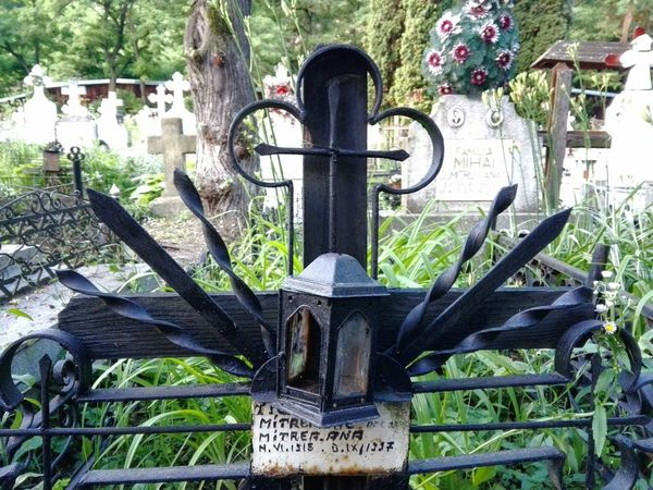 Bistrita cimitery, near Piatra Neamt, Romania, a traditional romanian metall cross Close-up Cross Day God Grass Grave Grave Cross Green Color Growth Information Sign Memories Metal Cross Nature No People Old Outdoors Plant Religion Romanian Cimetery The Past Tree