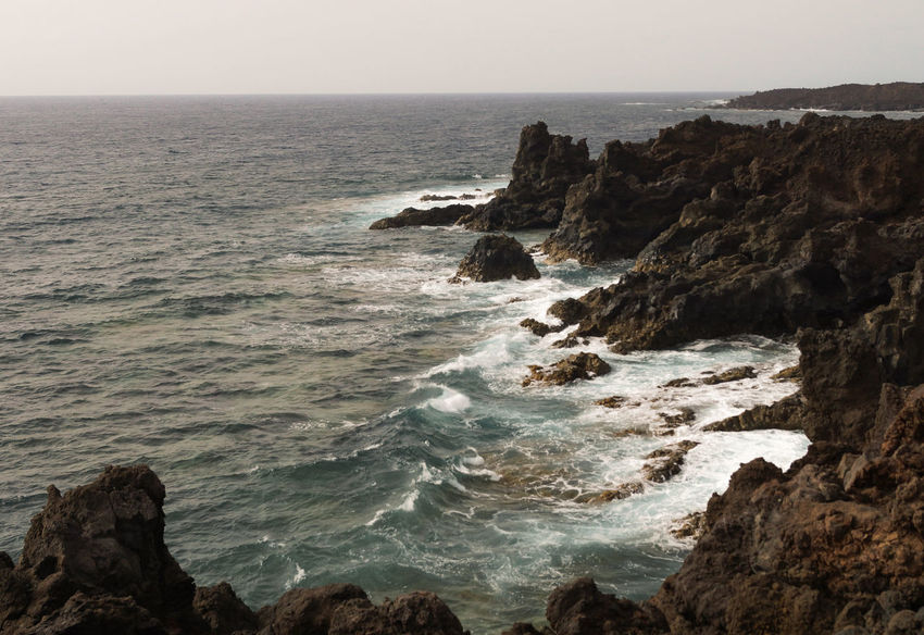 Hervideros Lanzarote SPAIN Back Rock Beach Beauty In Nature Clear Sky Cliff Day Hervideros Horizon Over Water Nature No People Outdoors Rock - Object Scenics Sea Sky Tranquil Scene Tranquility Volcanic Landscape Water Wave