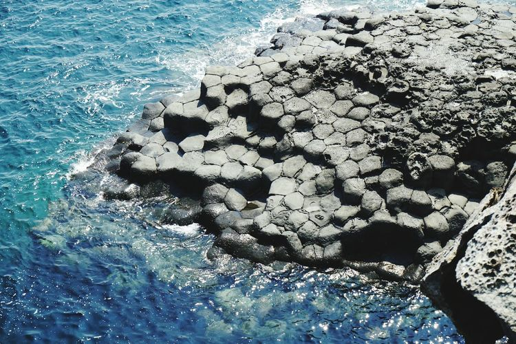 nature's wonders Nature Sea Textured  Sunlight Beach Beauty In Nature Close-up High Angle View Outdoors Jeju Travel Destinations Geo Site Volcanic Landforms Volcano Volcanic Landscape