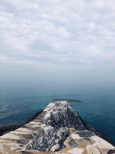 Jump into the unknown Calm Sea And Sky Unknown Cloud - Sky Water Sea Beauty In Nature Sky Scenics - Nature Tranquility Idyllic Rock No People Horizon Nature Horizon Over Water